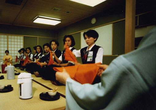 Japan Air Lines flight attendant trainees get a tea ceremony lesson, Tokyo, Japan.