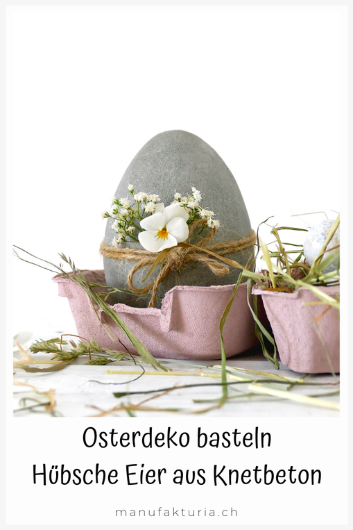 Ei aus Knetbeton im rosa Eierkarton dekoriert