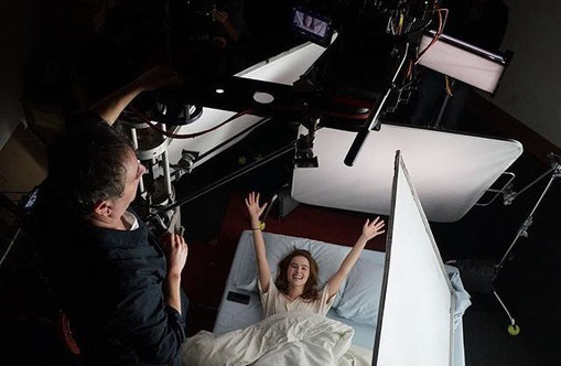 Image of elevated camera shooting actress Zoey Deutch waking up in bed, from the movie Before I Fall.