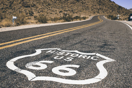 Route 66 sign on the road in California