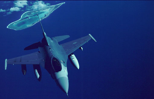 A Korea-bound F-16 passes over mid-Pacific Wake Island.