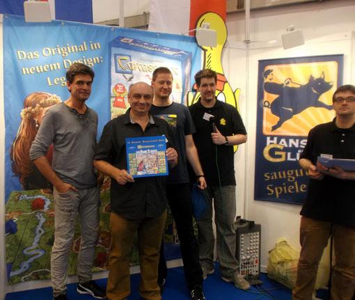 v.l. CC-Autor Wrede, H. Niehoff und Mitarbeiter vom Veranstalter Spielezentrum Herne