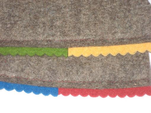 Bogenbordüre auf braun-meliertem Filz : rot/Muster 20, grün/Muster 21, gelb/Muster 22, blau/Muster 23