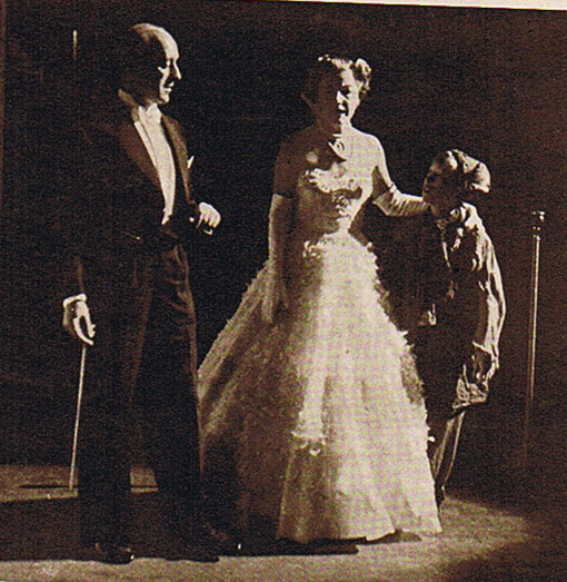 The show is on. This photograph of Alec Guinness, Irene Dunne and Andrew Ray was taken from the wings during the actual Empire performance.