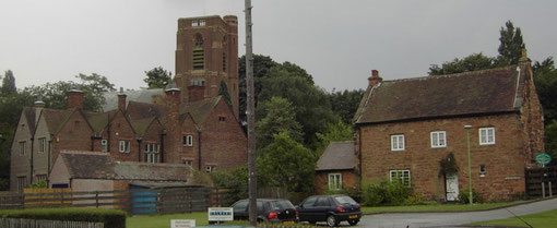 The Old Stone House (right) and St Peter's Church. The building in front of the church is the vicarage.