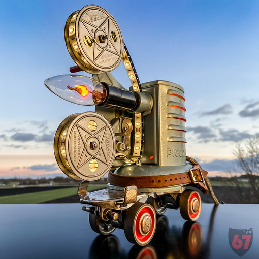 Upcycling light artwork with antique Noris Piccolo film projector, Hudora roller skate, LED stripe and glow bulbs - JayKay67Design by Jürgen Klöck