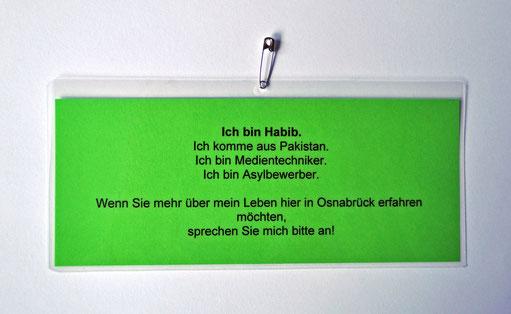 Laminiertes Schild (grün), 8 x 21 cm, Sicherheitsnadel, 2014