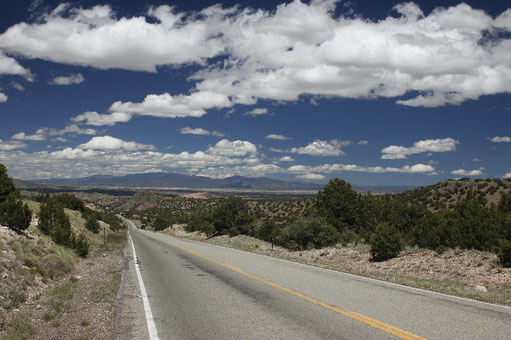 Highway 14 close to Madrid, New Mexico, beautiful landscape, clouds, red rocks, desert