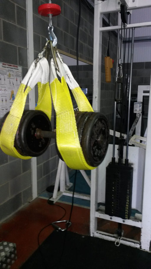 Electric hoists for safety when lifting heavy, lift dumbells up with the hoists, take the weight, lower the slings and remove and start pressing.