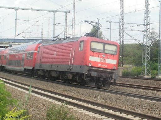 Am 5. August 2011 verlässt ein RE mit 112 107-6 gerade Luth. Wittenberg Hbf.