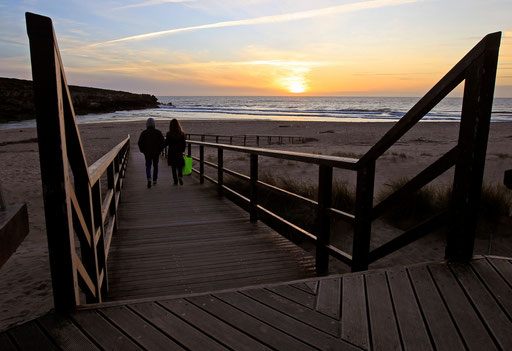 Couple walks to the beach on a sunset at Lisandro beach on the Atlantic sea coast of Portugal 40Km North of Lisbon March 20, 2013.