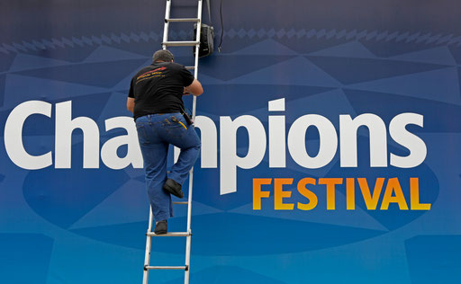 Worker finish the entrance to the UEFA Champions playground in Lisbon, 2014