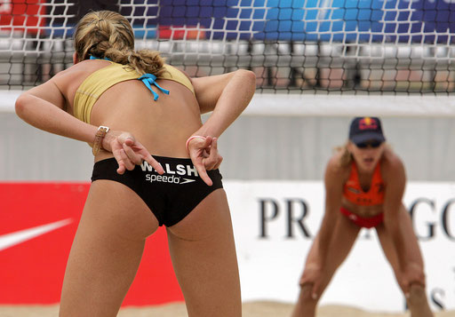 U.S. beach volleyball player Kerri Walsh (L) gives instructions to her team mate in front of Greece Maria Tsiartsiani (R) during their final match of the FIVB World Tour 2005 in Espinho Northern Portugal July 16, 2005.