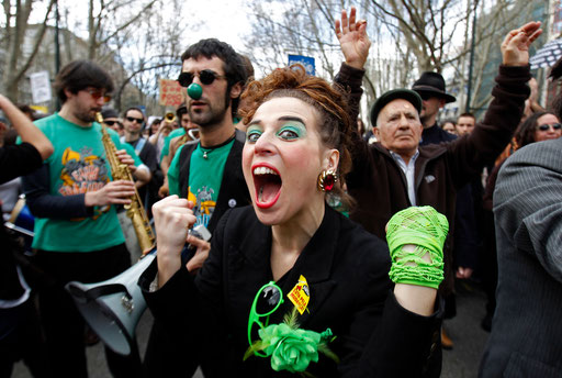 "People protest during the ""Geracao a Rasca"" demonstration on Lisbon's main avenue of Liberdade March 12, 2011."