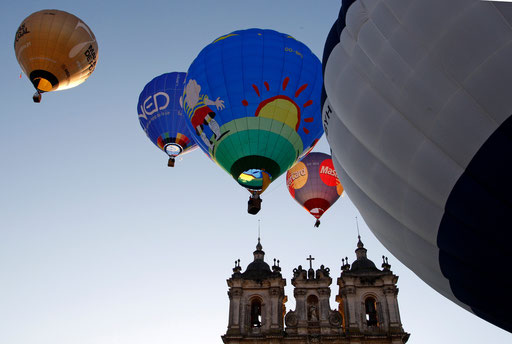 Balloons fly on their stage four of the Portugal Hot Air Balloon Transcrossing in front of Alcobaca monastery April 2, 2008.