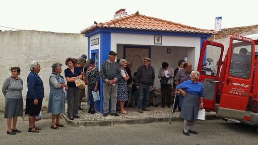 Senior citizens queue to receive their pensions in Assafora 45 km North of Lisbon June 1, 2011