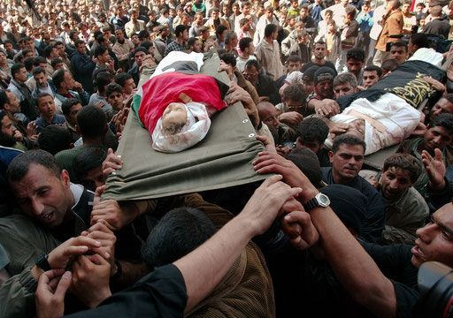 A four year old Palestinian girl Elham al-Assar is carried to the mosque in the Nuseirat refugee camp in the central Gaza Strip during a funeral ceremony March, 2003