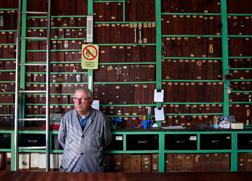Francisco Santos looks to the door of his ironmonger shop waiting for clients in Sintra May 25, 2011.