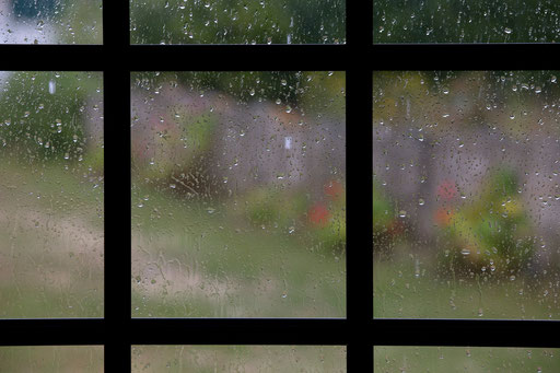 Rain drops are seen on a window at Assafora village North of Lisbon in 2014