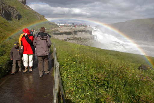 People walk on a corridor to visit a waterfall in Iceland July 24, 2009.