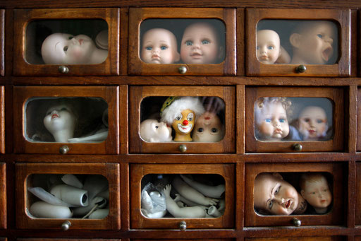 Dolls heads and body parts are displayed in drawers at the Doll Hospital in Lisbon December 17, 2009.