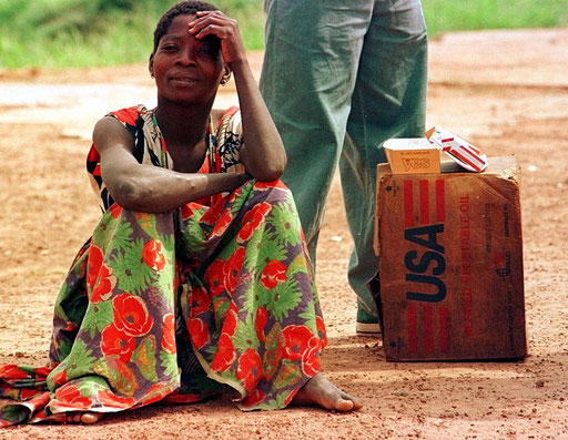 Woman waits by food deliverage in Angola on November 1995.