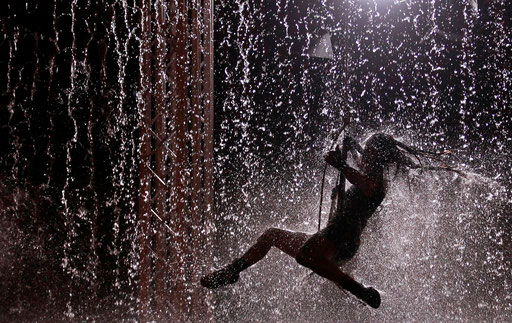 Artist performs during the Waterwall show in Lisbon August 5, 2011.