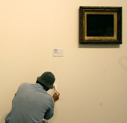 A worker gives final touches to the walls in the Berardo Museum of Modern and Contemporary Art in Lisbon June 25, 2007.