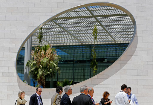 Medical conference participants take a walk during a coffe brak at Champalimaud Conference Center in Lisbon on 2015