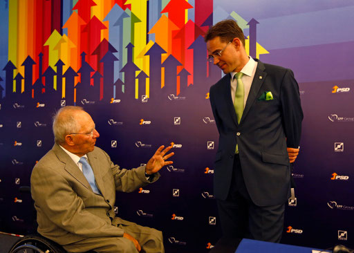 German Finance Minister Wolfgang Schauble talks to Finland Prime Minister Jyrki Katainen prior their European Popular Party (EPP) Meeting in Albufeira on 2014