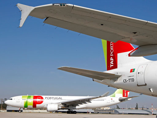 TAP Portugal airlines' Airbus 320 aircraft maneuver behind another Tap Airbus 319 at Lisbon airport March 29, 2012.
