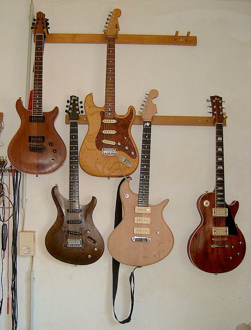 2006: Shortly after it was completed. On the wall in the Formentera Guitars` workshop together with luthier Ekki Hoffmann`s own beautiful creations. Check the crown inlays on this Les Paul on the right. Click to enlarge.