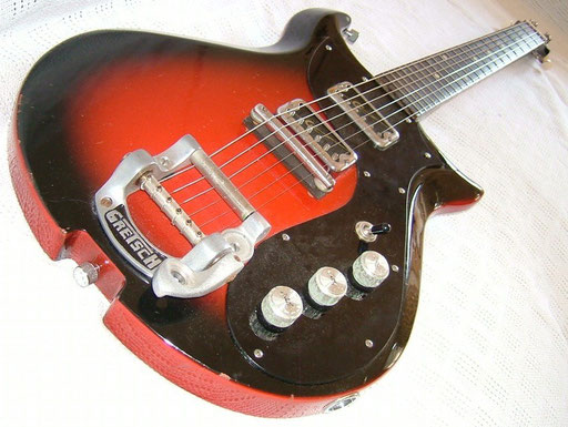 ...and maybe the 1-ply pickguard. Note the weird finish. Black on top, red on the side...