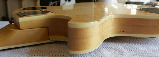 sandwich or pancake construction on this all maple guitar