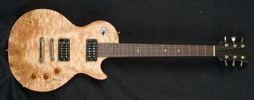 Frankie`s maple neck Les Paul with that stunning top and unconventional fretboard dots, too.
