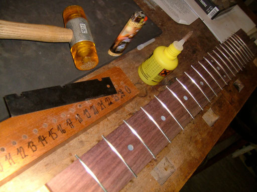 Not all guitar companies glue the frets in. Some think it is good enough just to press them in. We used a hammer instead after the glue had been applied.