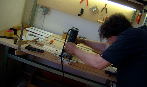 Frankie routing the arched truss rod channel in his beautiful flame maple neck blank