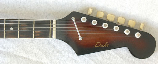 Very beautiful matching sunburst headstock.Note the fretboard: Must have been dyed and wears off. Click to enlarge