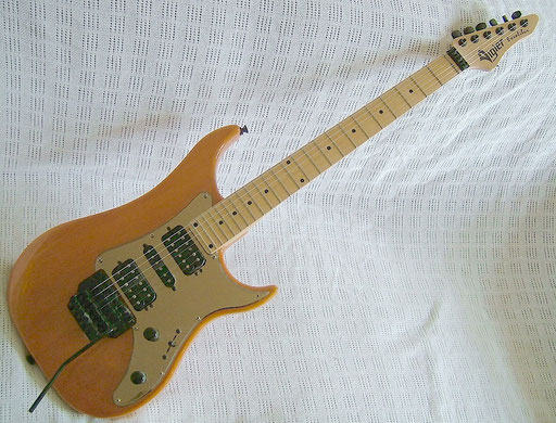 Vigier Excalibur Standard with Kahler, DiMarzios, with a wizzard neck as substantial as a stamp.