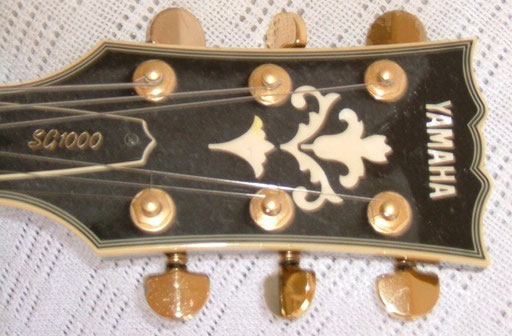 The headstock is black, just the dust is grey...