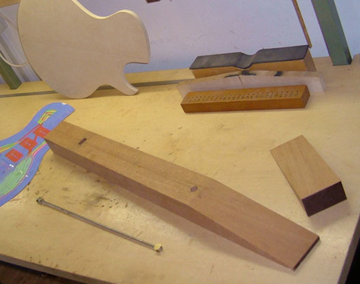 My mahogany neck blank with the truss rod channel and the truss rod before it got bent