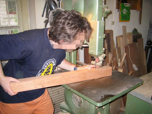 sawing a piece of mahogany off the neck blank. This is the headstock`s back angle.