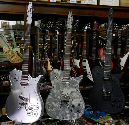 Chris Larsens new M-9 models from 2011 or 2012 at Acme Guitars in St. Louis