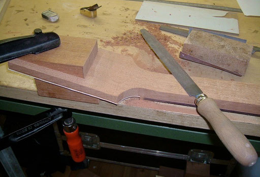 the rest is done by hand. Note that the triangular headstock piece that had been sawn off first is back in use here.