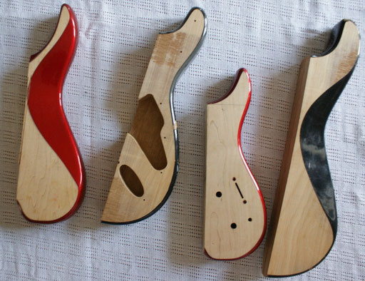 Cutting guitar bodies in pieces reminds me of modern art and postmodern architecture ... Deconstructivism with a hint of cubism. The Steinberger pieces are the red ones.
