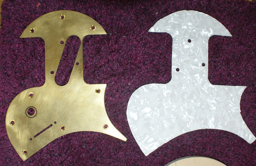 ... and had a brass and an aluminum pickguard cut with water jet pressure and fucked up building mother-of-toilet seat models. Ugly material anyway!