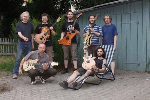 Why life in Hannover, Germany, is really great: Paul (left) and Thomas Stratmann (right) and 5 very happy customers with their self built dream guitars.