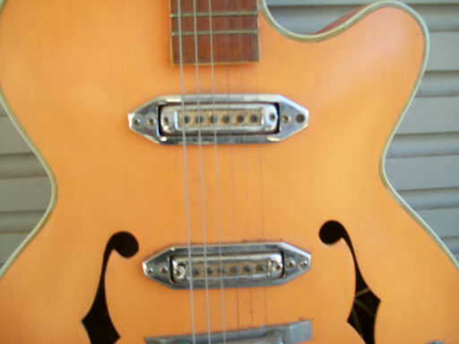 these super-super rare pickup rings are original and as rare as the pot knob rings... What was the logo on the headstock?