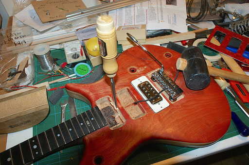 Make space for a humbucker, dumb sucker! Chisel to enlarge cavity