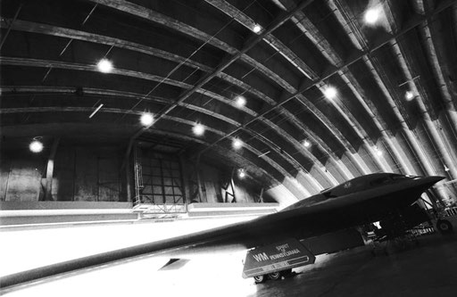 A B-2 Spirit stealth bomber in a hangar at Anderson Air Force Base, Guam. Its otherworldly lines seem like something straight from a science-fiction novel.